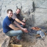 The two sons, now adults, enjoying a driftwood BBQ on Marloes Sands